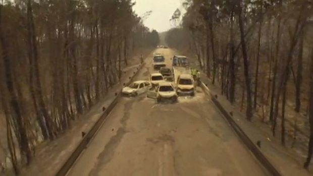 Drone video shows burnt cars on the road between Pedrogao Grande and Figeiro Dos Vinhos, Portugal, after a forest fire ...