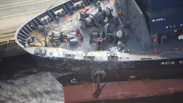 The container ship ACX Crystal with its left bow dented after colliding with the USS Fitzgerald in the waters off the ...