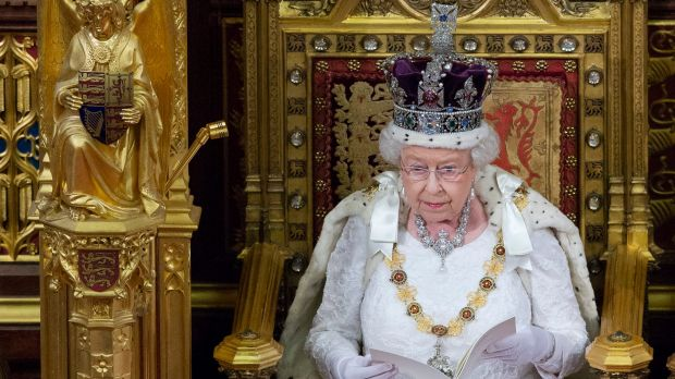 Elizabeth II, wearing the Imperial State Crown, delivers the Queen's Speech to Parliament in the House of Lords last year.