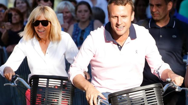 French President Emmanuel Macron and his wife Brigitte Trogneux leave their house  in Le Touquet-Paris-Plage on the eve ...