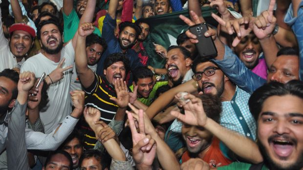 Win around the world: Pakistani cricket fans celebrate their team's victory in the Champions Trophy final against India, ...