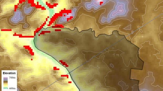 Map of elevation around the Ginninderry region, with the land subject to rezoning in dark shading. The red pixels ...