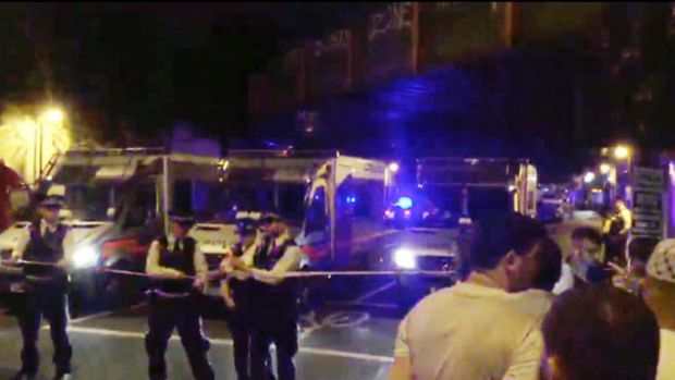 Police officers cordon off the area after a vehicle struck pedestrians near the Finsbury Park Mosque in London on Monday.