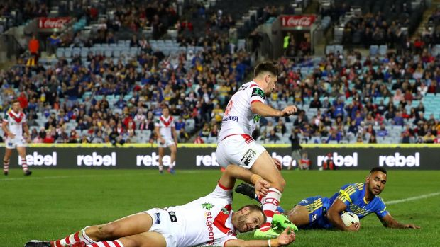 Mature approach: Bevan French scores a try against the Dragons.