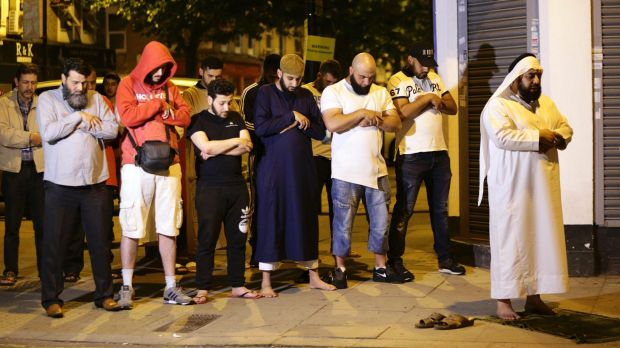 Muslims pray at Finsbury Park, where a vehicle struck pedestrians.