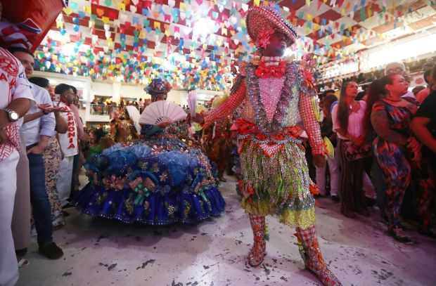 Dancers prepare to perform during a traditional Festas Juninas (June Festivals) party at the Salgueiro samba school in ...