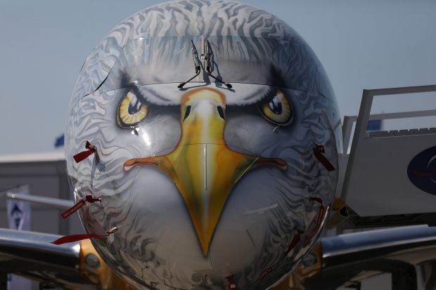 An eagle design sits on the nose of an Embraer SA E195-E2 aircraft ahead of the 53rd International Paris Air Show at Le ...