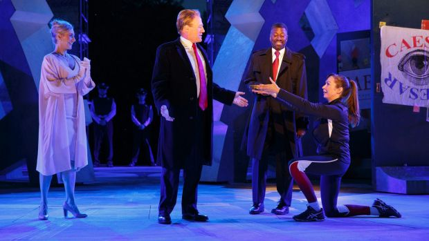 Tina Benko, left, in the role of Caesar's wife, Calpurnia, and Gregg Henry, centre left, portrays Julius Caesar during a ...
