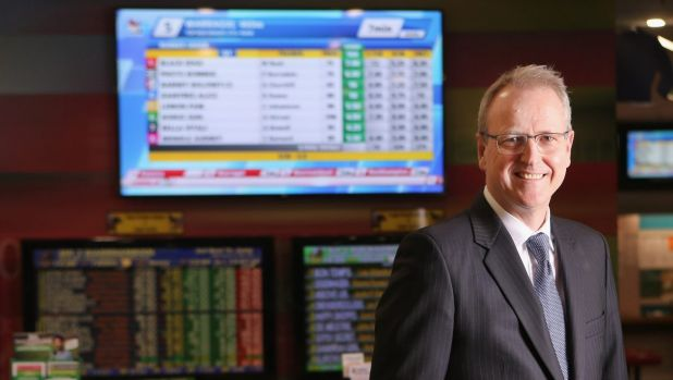 Tabcorp CEO David Attenborough has waited eight months for the Tatts merger decision.