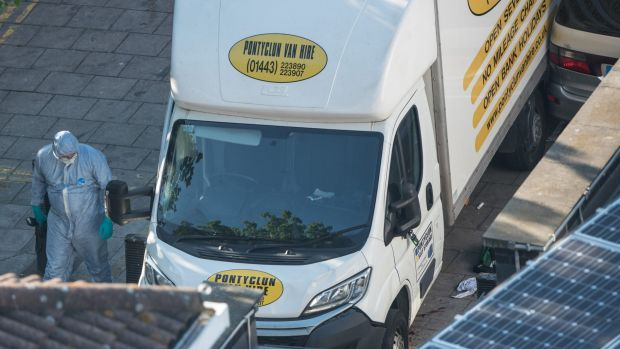 A police forensics officer examines the van believed to have been used in the attack.