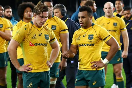 Down and out: Wallabies captain Michael Hooper (front left), Will Genia (front right) and the Wallabies come to terms ...