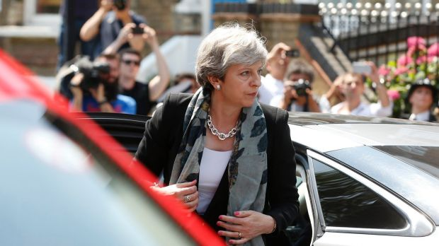 British Prime Minister Theresa May arrives near the scene where a van struck pedestrians.