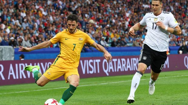 Mathew Leckie clears the ball while under pressure from Niklas Suele of Germany.