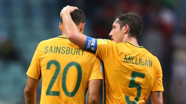 Trent Sainsbury and Mark Milligan embrace after their loss to Germany.