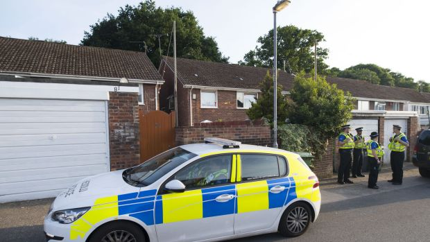 Police outside a property during a search of a house in Pentwyn, Cardiff, believed to be the home of Darren Osborne.