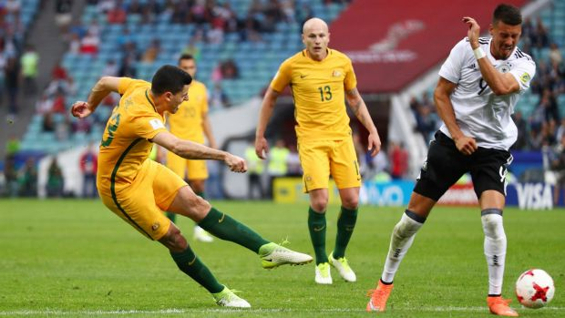 Attacking brightspot: Tommy Rogic shoots for goal for the Socceroos against Germany.