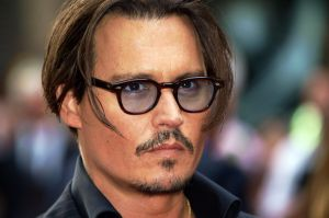 Johnny Depp has said sorry after joking in Britain about assassinating President Trump.