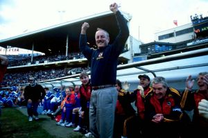 Adelaide Crow's coach Malcolm Blight jumps as the final siren blows for their second premiership win, the 1998 AFL Grand ...