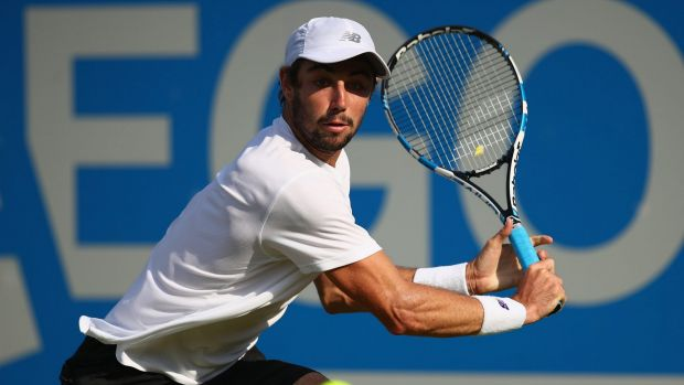 Jordan Thompson plays a backhand during his first round match against Andy Murray.