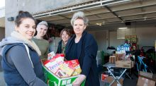 The stock inside Carly Montgomery's garage, (l-r) Carly Montgomery, mill worker's wife Sharran George and Dannie ...