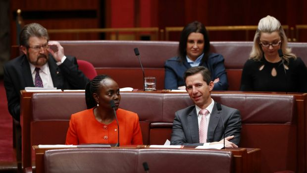 Deal done: Education Minister Simon Birmingham with crossbenchers Derryn Hinch, Lucy Gichuhi, Jacqui Lambie and Skye ...