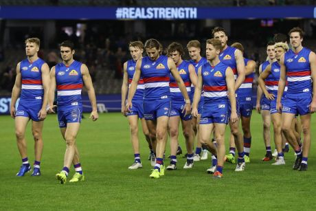 The Bulldogs leave the ground after their loss to the Demons.