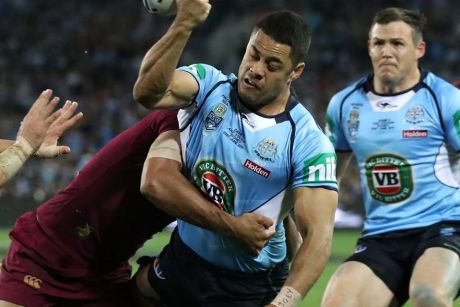 Bombed try: Jarryd Hayne is tackled by Will Chambers in a crucial moment at ANZ Stadium.