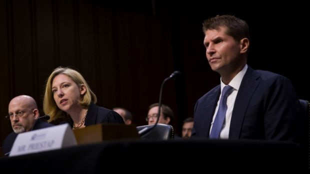 Jeanette Manfra of the Department of Homeland Security (DHS), centere, speaks at the hearing while Bill Priestap, of the ...