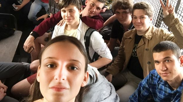 Lyusya Shteyn, foreground, sits in a police bus after being detained during an anti-corruption rally in Moscow on June 12.