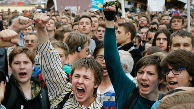Young protesters  are blocked by riot police during a demonstration in downtown Moscow. In many cases, Putin has run ...
