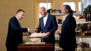"""David Jones CEO John Dixon (centre) says food provides a """"halo"""" effect as it brings in shoppers who can have a coffee ..."""