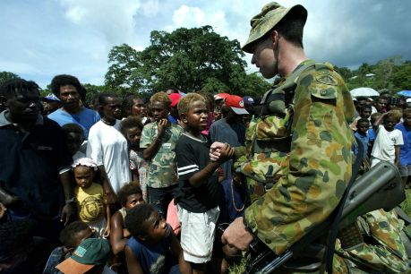 Australian soldier Pte Sean Lanigan meets locals in Honiara in 2003 after the Regional Assistance Mission, Solomon ...