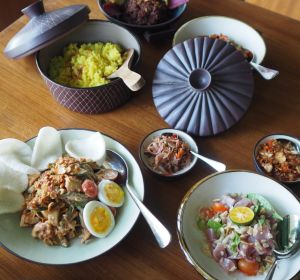 Clockwise from top left: Gado gado, turmeric coconut rice, braised beef, and smoked trevally braised in a mild curry at Kaum.