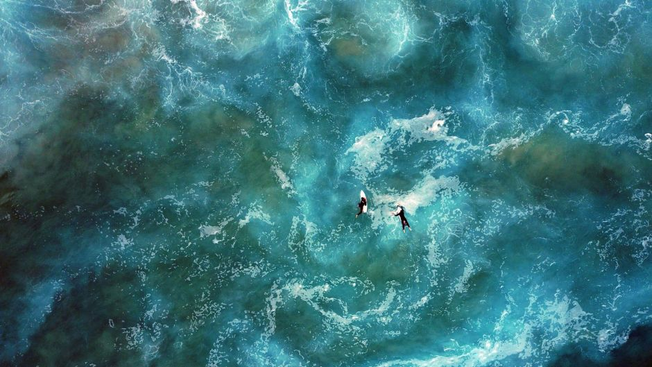 SYDNEY, NEW SOUTH WALES - JUNE 16: An aerial view of surfers at Mackenzies Beach on June 16, 2017 in Sydney, Australia. ...