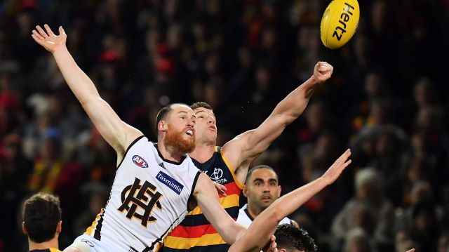 Hawthorn skipper Jarryd Roughead and Crow Josh Jenkins compete for the ball during their round 14 match at Adelaide Oval ...