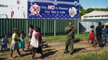 A police sign asking people to say no to Kwaso, a highly potent home-brewed spirit drink, is displayed outside the ...