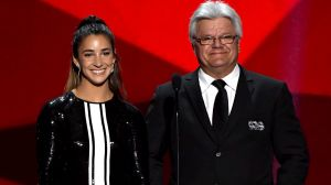 Gymnast Aly Raisman and former NHL player Marcel Dionne present onstage during the 2017 NHL Awards and Expansion Draft ...