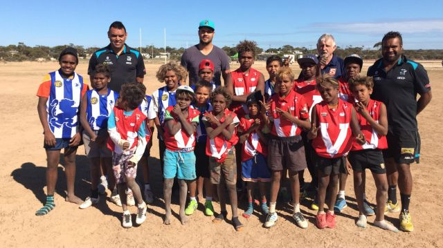 Giving back: Port Adelaide ruckman Paddy Ryder (centre) with Paul Vandenbergh (left), Byron Pickett (right) and kids at ...