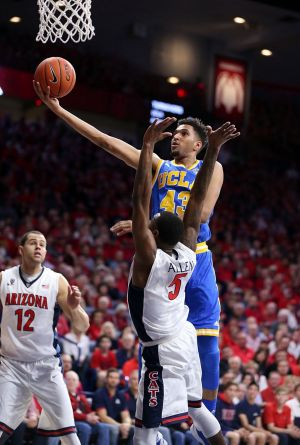 Jonah Bolden of the UCLA Bruins shoots over Kadeem Allen of the Arizona Wildcats during a college basketball game in ...