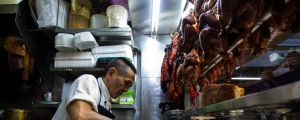 Chan Hong Meng prepares meals at his Hong Kong Chicken Rice and Noodle stall at Chinatown Complex on July 24, 2016 in ...