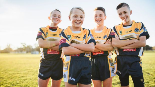 Tuggeranong Buffaloes under-12s players Owen Lewis, Will Purcell, Kai Callaway, and Reece Petrovic are happy to help Eli ...