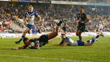 Ken shine: Warriors winger Ken Maumalo dives over for a try.