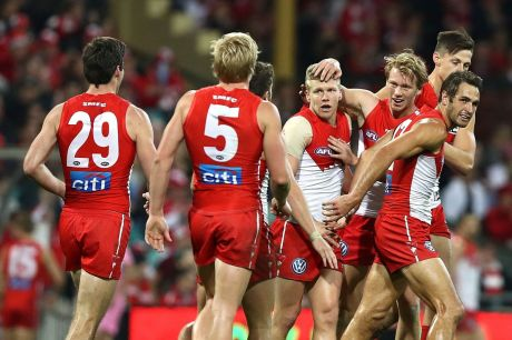 Big comeback: Dan Hannebery of the Swans celebrates a goal.