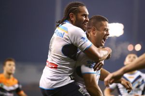 Game-breakers: Konrad Hurrell and Jarryd Hayne of the Titans celebrate Hayne scoring a try.