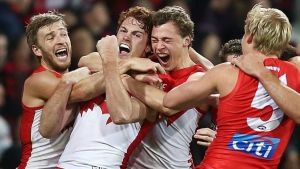 SYDNEY, AUSTRALIA - JUNE 23: Gary Rohan of the Swans celebrates with team mates after kicking a goal to win the match ...