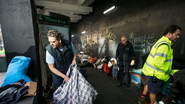 Nigel Blakemore, who had been living in Martin Place, cleans up belongings after the City of Sydney removed the homeless ...