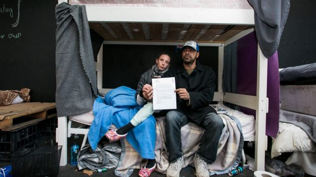 Sandra Sheldick and Jason Nichols on the bed they had been living on, before it was moved by the City of Sydney.