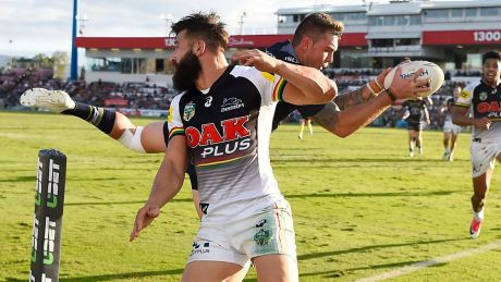 Acrobatics: Kyle Feldt of the Cowboys catches a high ball to score a try against Penrith at 1300SMILES Stadium on Saturday.