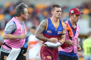 BRISBANE, AUSTRALIA - JUNE 24: Dayne Beams of the Lions leaves the field injured during the round 14 AFL match between ...