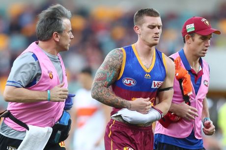 Dayne Beams leaves the field injured early in the match against GWS.